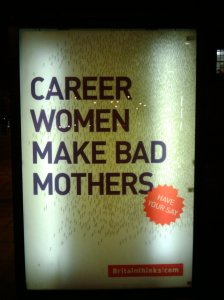 "Photo of a billboard reading ""Career women make bad mothers"""